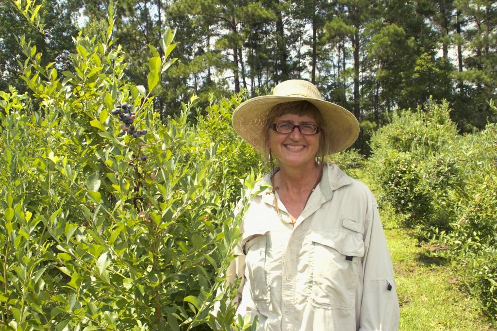 Cheri Ward keeps bees at Blue Pearl Farms. (Photo by Britton Holmes)